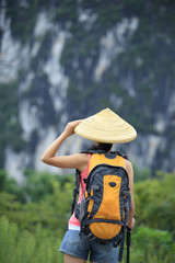woman hiker hiking in the guilin scenery,china