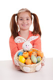 beautiful little red-haired girl with pigtails holding Easter eg