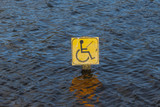 Disabled fishing sign in centre of lake