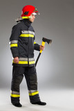 Fireman with axe, side view.