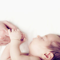Baby and fathers hand, parental love