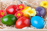 Colorful Easter Eggs in a Wooden Box in Closeup