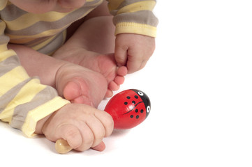Baby hand with red toy