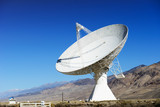 Satellite dishes in desert / clear blue sky