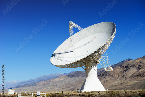 Satellite dishes in desert / clear blue sky