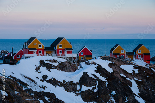 Arctic Wooden houses with dusk sky, Sisimiut, Greenland.