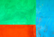 Blue, green and orange painted wall, abstract background