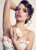 beautiful young brunette woman with rose