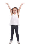 girl standing with hands raised