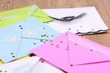 Bunch of color envelopes and confetti close-up