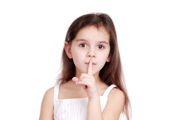 Girl holding the finger at the lips