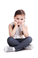 girl sitting on the floor on white background