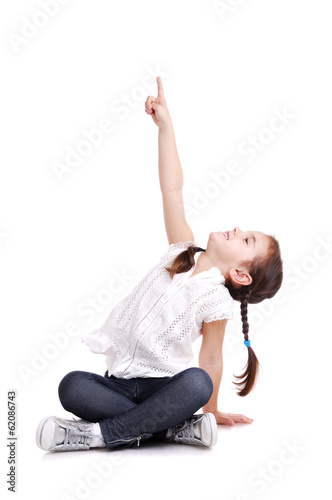 girl sitting on the floor with hand raised