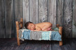 Newborn Baby Boy Sleeping on a Tiny Bed
