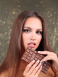 Portrait of beautiful young girl with chocolate