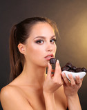Portrait of beautiful young girl with chocolate candies