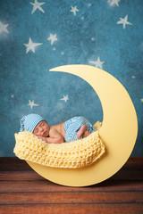 Newborn Boy Sleeping on the Moon