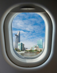 porthole, top view on the blue sky and clouds