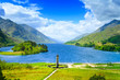 Glenfinnan Monument and Loch Shiel lake. Highlands Scotland Uk