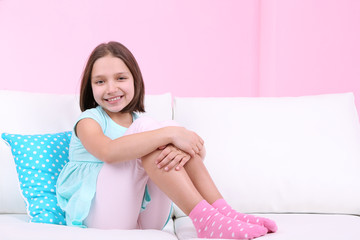 Beautiful little girl sitting