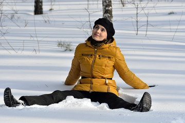 woman sitting in the snow