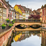 Colmar, Petit Venice, bridge, water canal, traditional houses. A