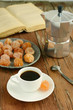 Cup of black coffee and dried kumquats