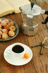 Coffee in vintage pot and sugared kumquats