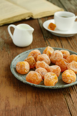 Dried kumquats on rusted metal plate