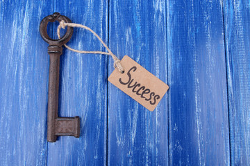 Key to success, Conceptual photo. On color wooden background