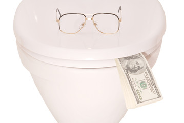 White toilet bowl glasses and money (Clipping path)