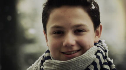 Portrait of happy cute young boy in snowy weather