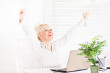 Business woman in the office with raising hands