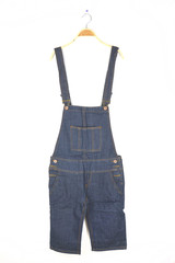 hanging dungarees on white wall