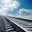 railroad closeup to horizon in sky with sun