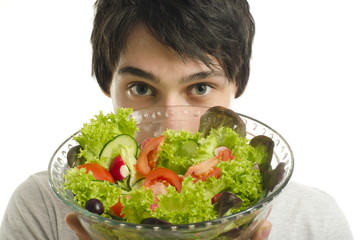 Close up on man holding a bowl of organic salad, eating healthy
