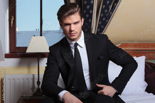 young business man sits by the window