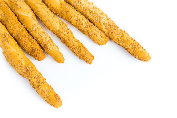Sesame breadsticks on white background
