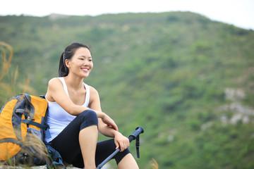 woman hiker enjoy the view  sit on mountain peak