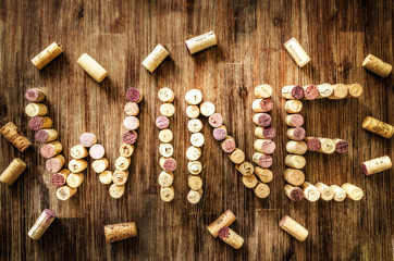 Sign wine made from corks on old wooden vintage table