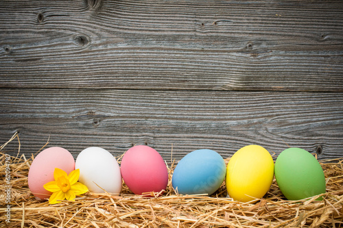 eater eggs on old wooden background