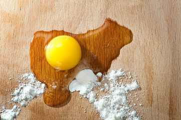 Egg and flour on a cutting board