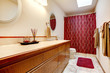 Cozy bathroom with red rug and curtains