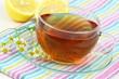 Tea, fresh chamomile flowers and lemon