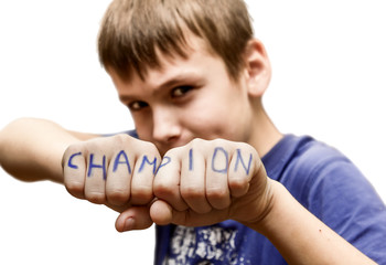 "A boy stands in a fighting pose, with the words ""champion"" on"