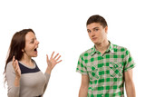 Excited young woman gesturing at her boyfriend