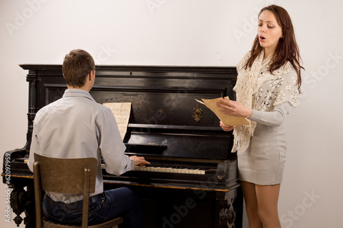 Young couple giving a classical duet
