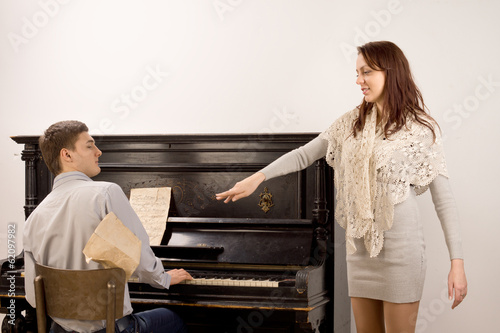 Young woman acknowledging the pianist