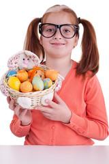 Portrait of little girl with glasses holding Easter egg basket
