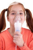 young girl keeping inhale mask